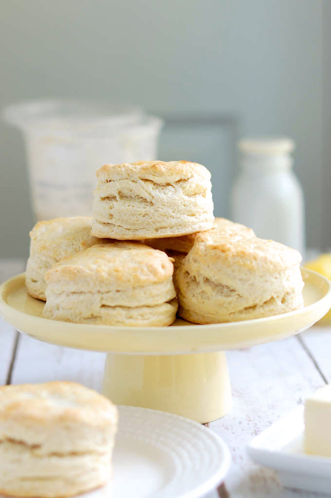 A cake stand stacked with fresh sourdough biscuits