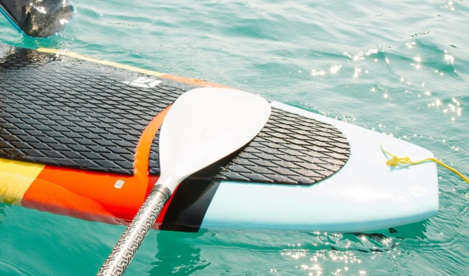 Solid or foam stand up paddle boards sit lower in the water than ISUP's