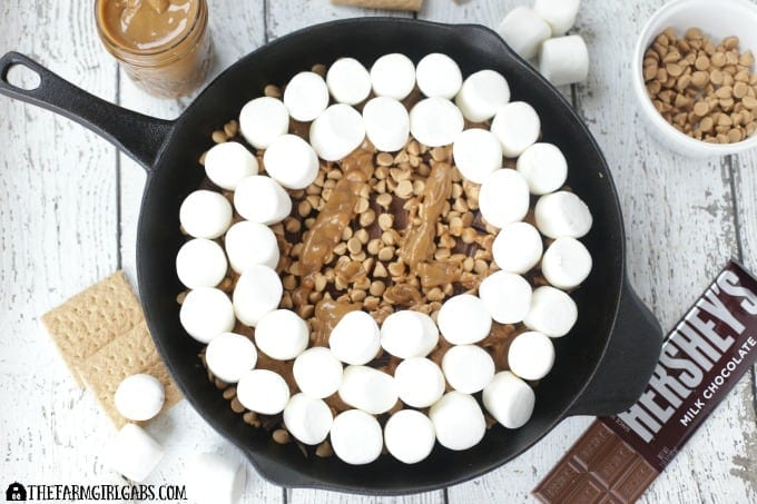 Chocolate Peanut Butter Skillet S'mores are an updated twist of the campfire classic. This recipe has the perfect amount of chocolate and peanut butter.