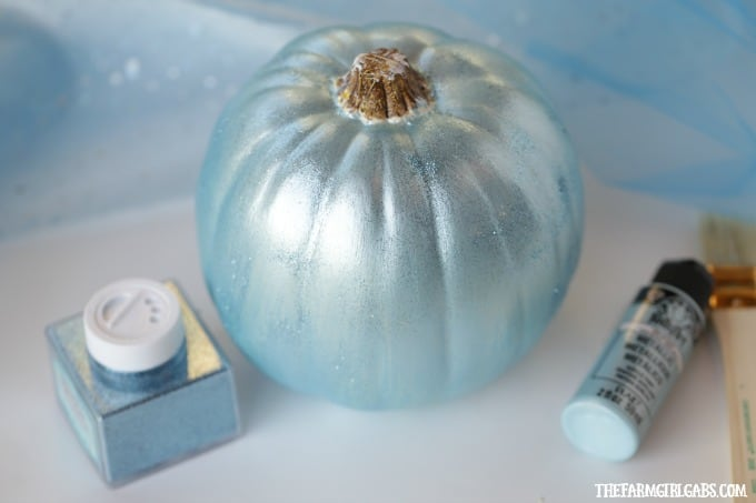 Your little princess will love making this beautiful DIY Disney Cinderella Pumpkin for Halloween. This no-carve pumpkin craft is bedazzled with gems, tulle and metallic blue paint to match Cinderella's gown.