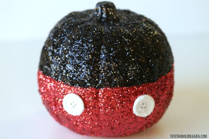 Oh boy! Make your Disney Halloween swell with this easy DIY Mickey Mouse Glitter Pumpkin.