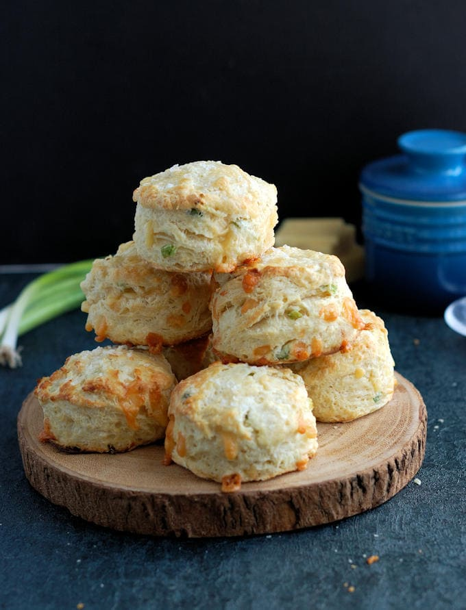 A tray of freshly baked Irish Cheddar Cheese Scones against a dark background.