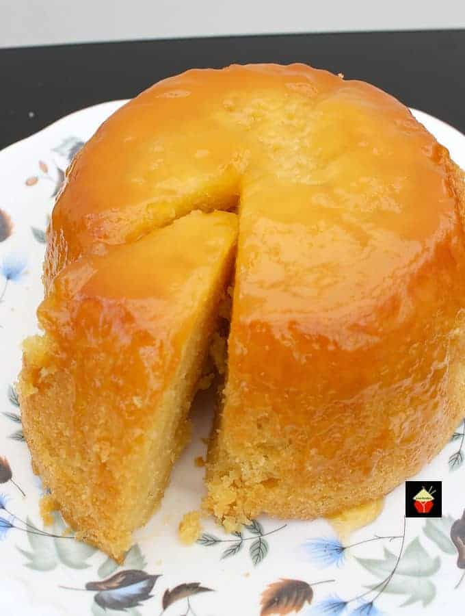 Lemon Steamed Cake or pudding is a lovely soft and fluffy cake steamed on the stove top, steamer or multicooker.