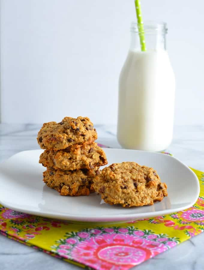 Peanut Butter Oatmeal Breakfast Cookie on a white plate with milk.