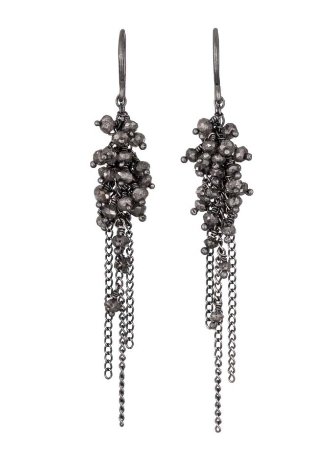 Photo of diamond beaded earrings with oxidised silver chain on white background.