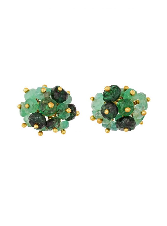 Photo of emerald beaded stud earrings on white background