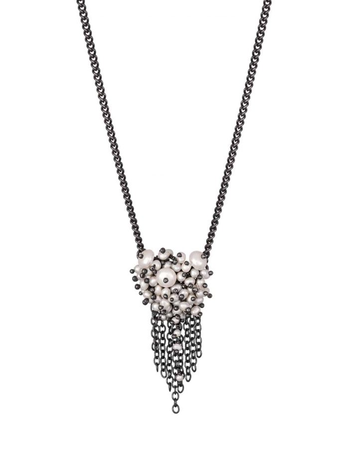 Photo of pearl and oxidised silver chain necklace on white background.