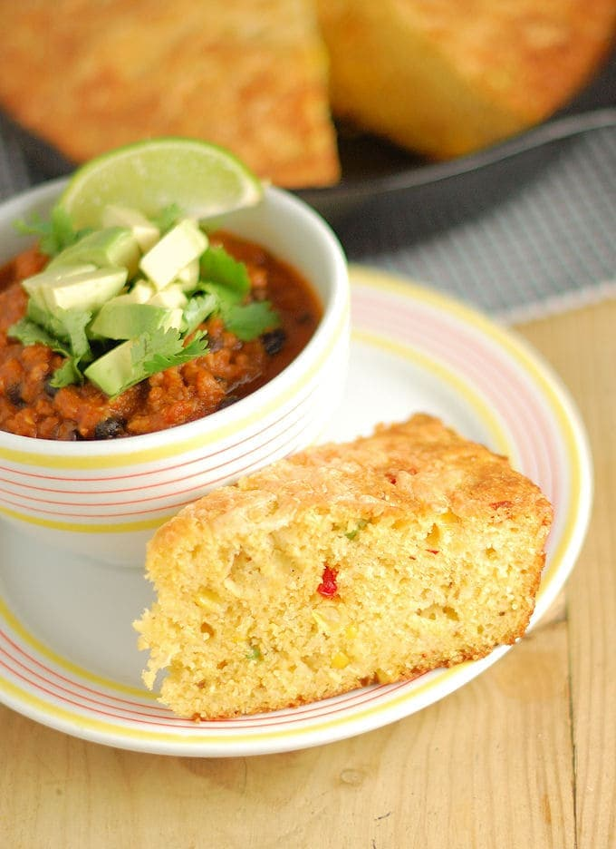 a slice of skillet cornbread and a bowl of chili
