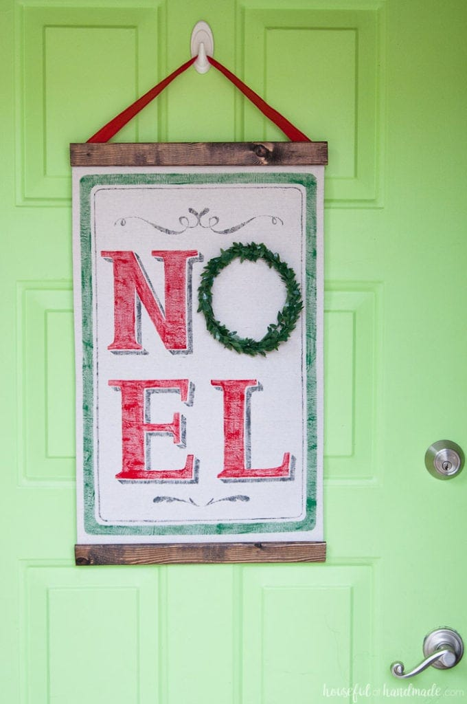 Love the look of vintage Christmas decor but don't have the budget for it? You can make this DIY vintage Christmas scroll with a few feet of drop cloth and some paint. Use a Silhouette Cameo to make a vinyl stencil for perfectly painted lines. It's the perfect not-so-vintage Christmas decor.   Housefulofhandmade.com
