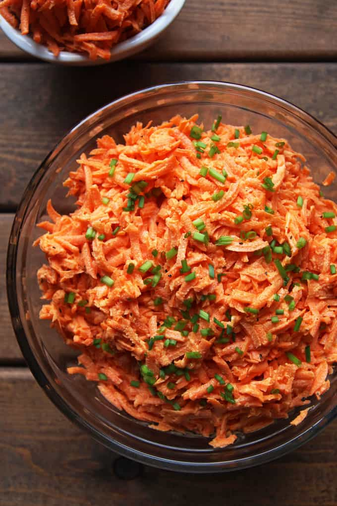 Creamy Shredded carrot salad in glass bowl