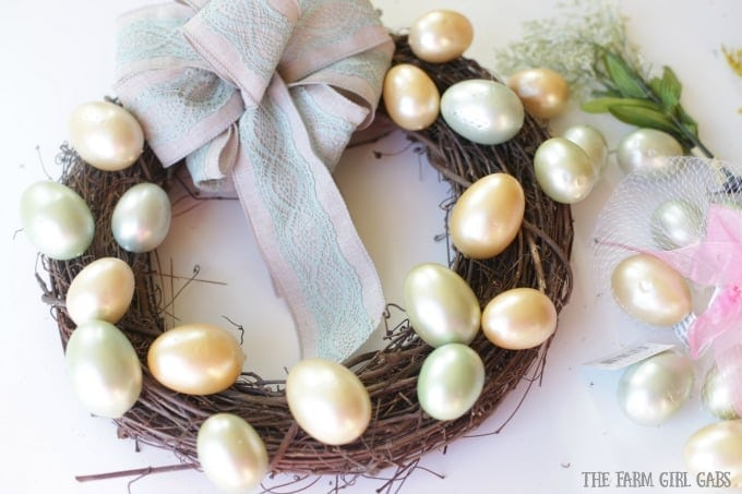 Brighten up your front door with this easy and welcoming DIY Spring Easter Egg Wreath. It's the perfect way to welcome spring. #SpringWreath #Easter #Wreath