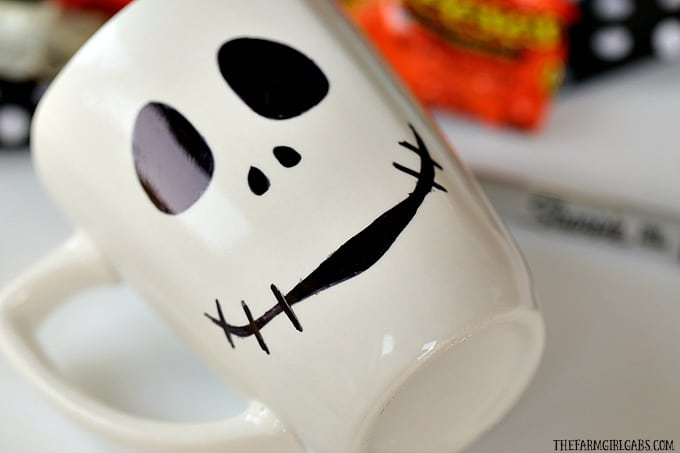 This DIY Jack Skellington Sharpie Mug is no tricks and all treats. This easy Nightmare Before Christmas craft makes a great party favor too!