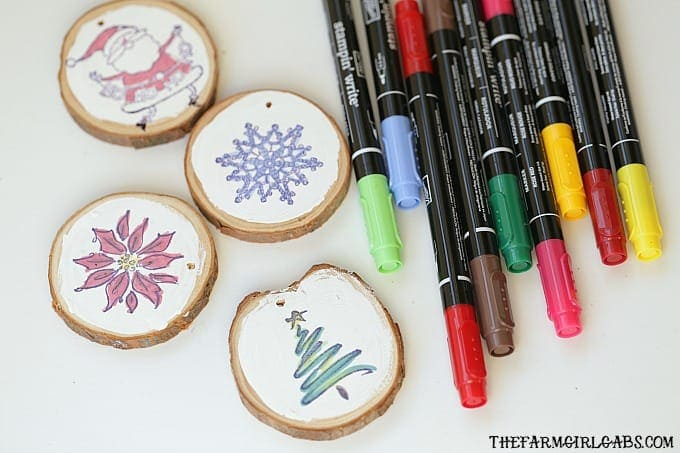 Create these Wood Slice Ornament Gift Tags to adorn your gifts with and hang on the Christmas tree.