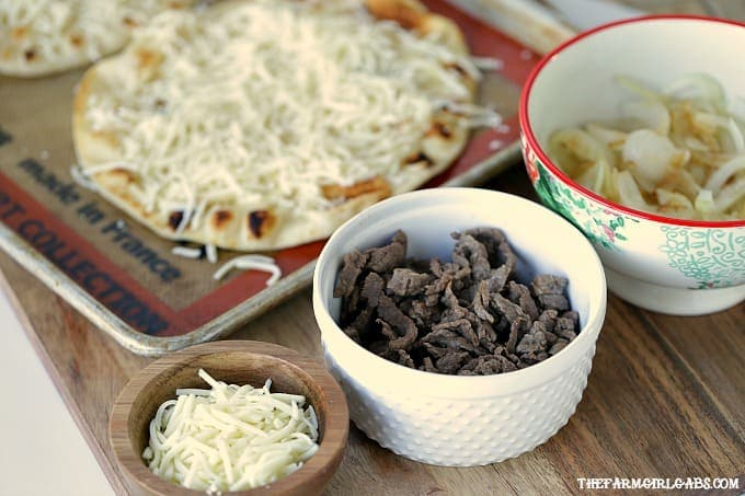 Classic Philadelphia Cheesesteaks rule in my neck of the woods. This Philly Cheesesteak Flatbread is the perfect recipe tocelebrate the sandwich Philadelphia made famous.