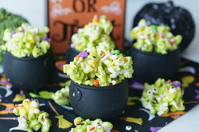 Double, double toil and trouble, Fire burn, and cauldron bubble. Stir up a batch of this ghoulish Cauldron Corn for some Halloween fun. #Halloween #Halloweenparty #HalloweenCandy #Snacks #Popcorn