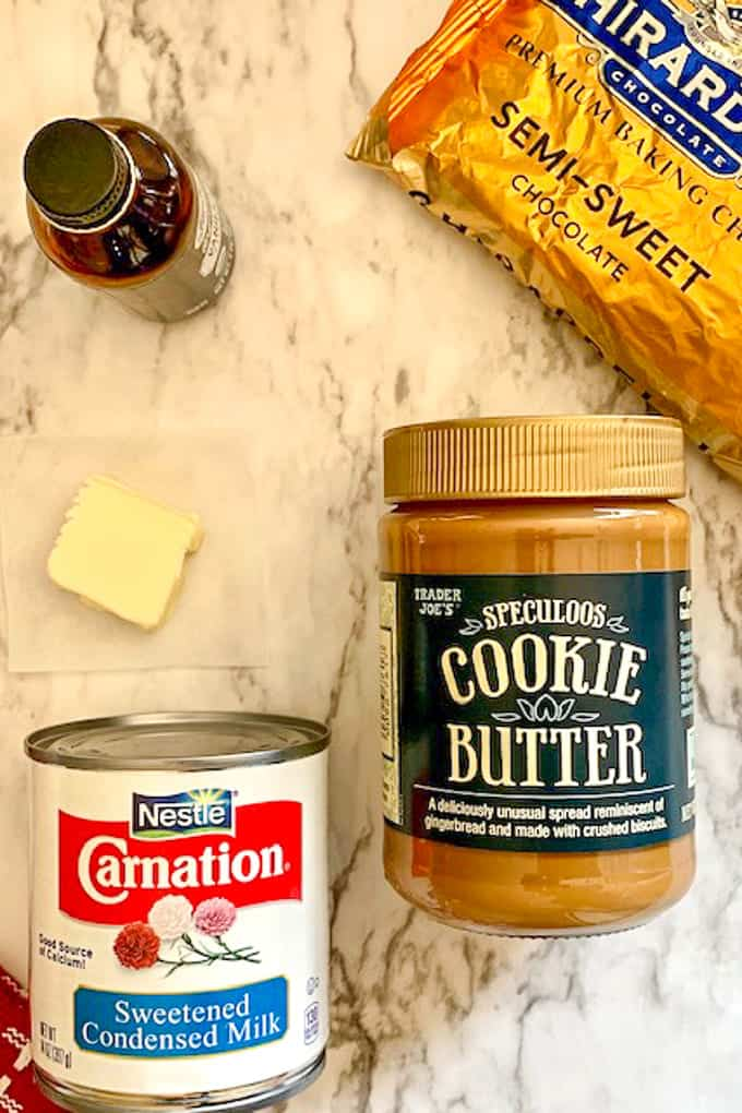 Ingredients for cookie butter fudge on a marble countertop