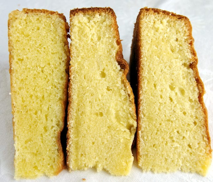 Three slices of vanilla cake side by side on a white background.