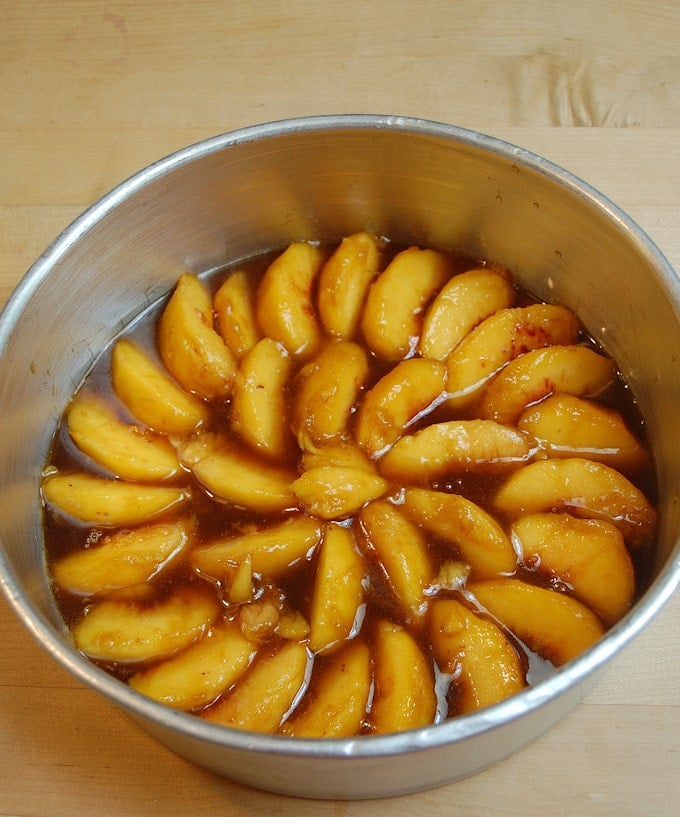 peaches and caramel in a cake pan.