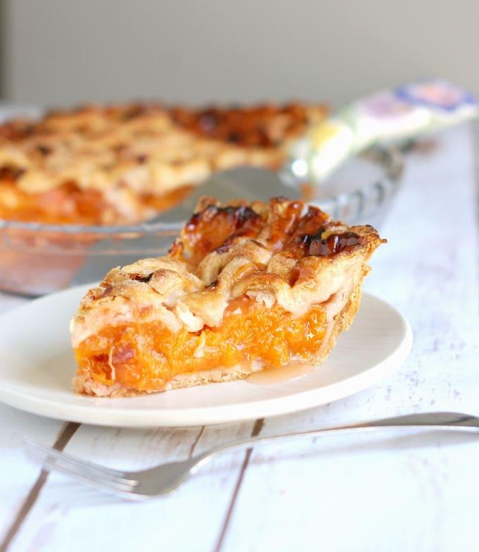 a slice of apricot raspberry pie