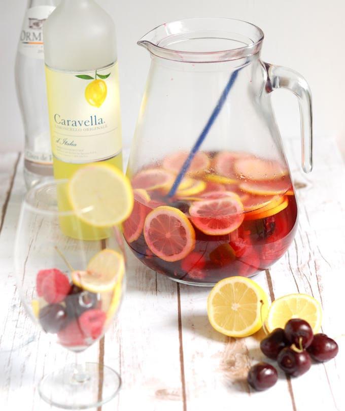 a jug of pink lemonade sangria