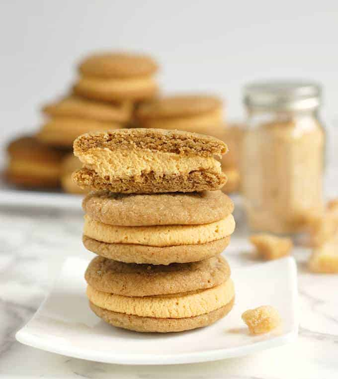 a stack of Ginger Sandwich Cookies with pumpkin ganache