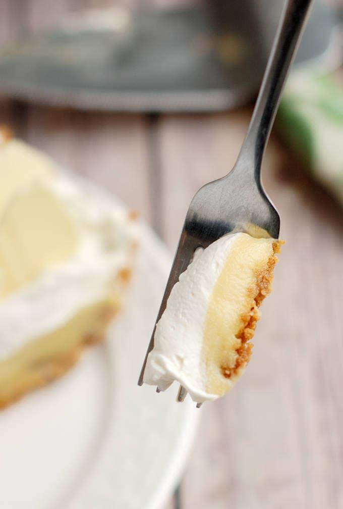 a fork holding a bite of malted milk cream pie