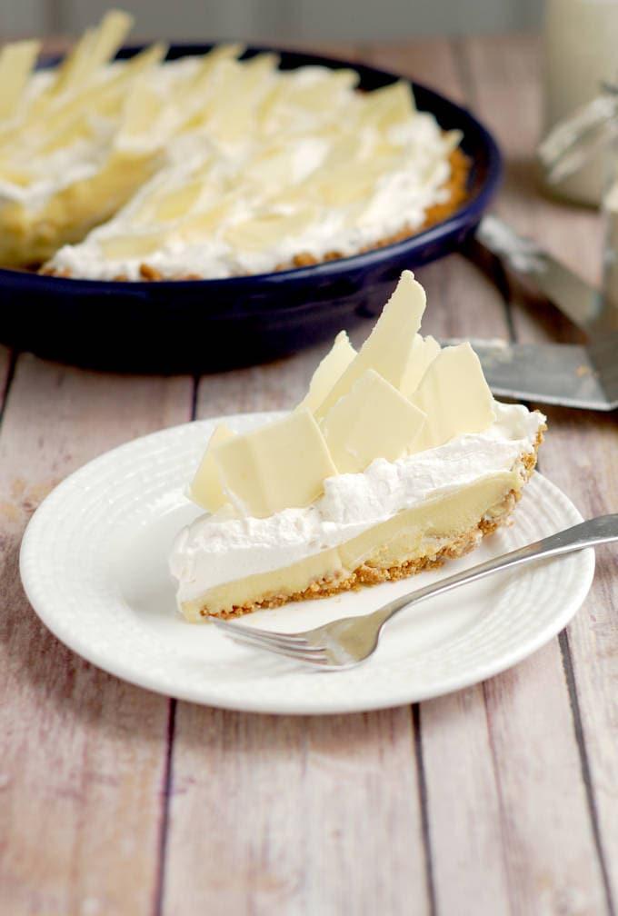 a slice of malted milk cream pie with white chocolate shards