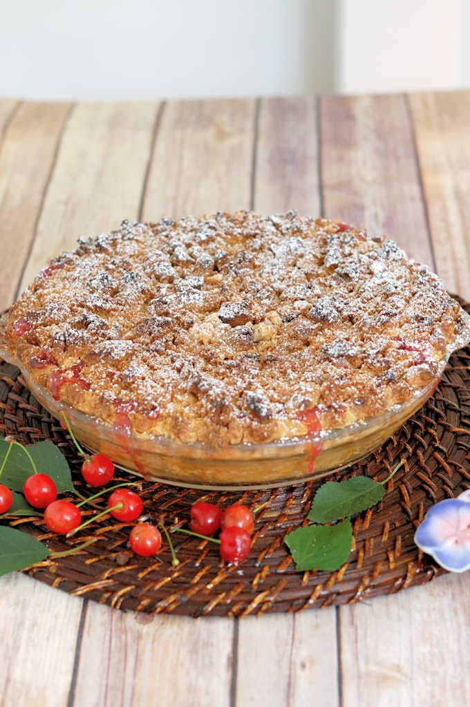 a sour cherry crumb pie on a table