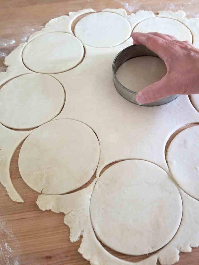 cutting circles from a sheet of pie dough