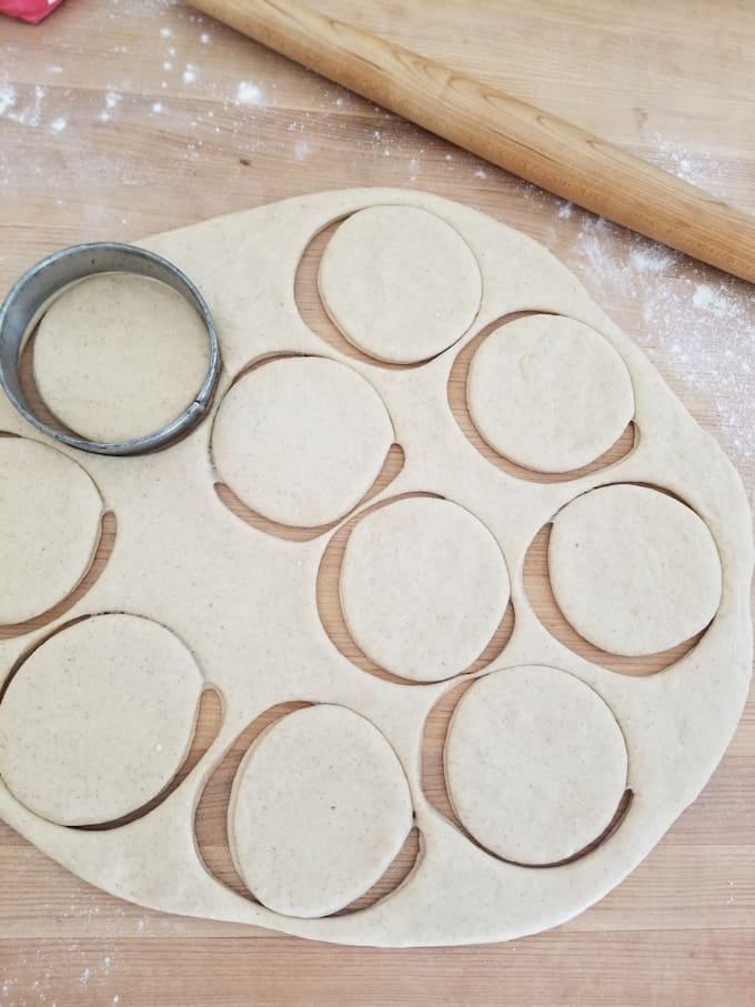 a sheet of dough with circles cut