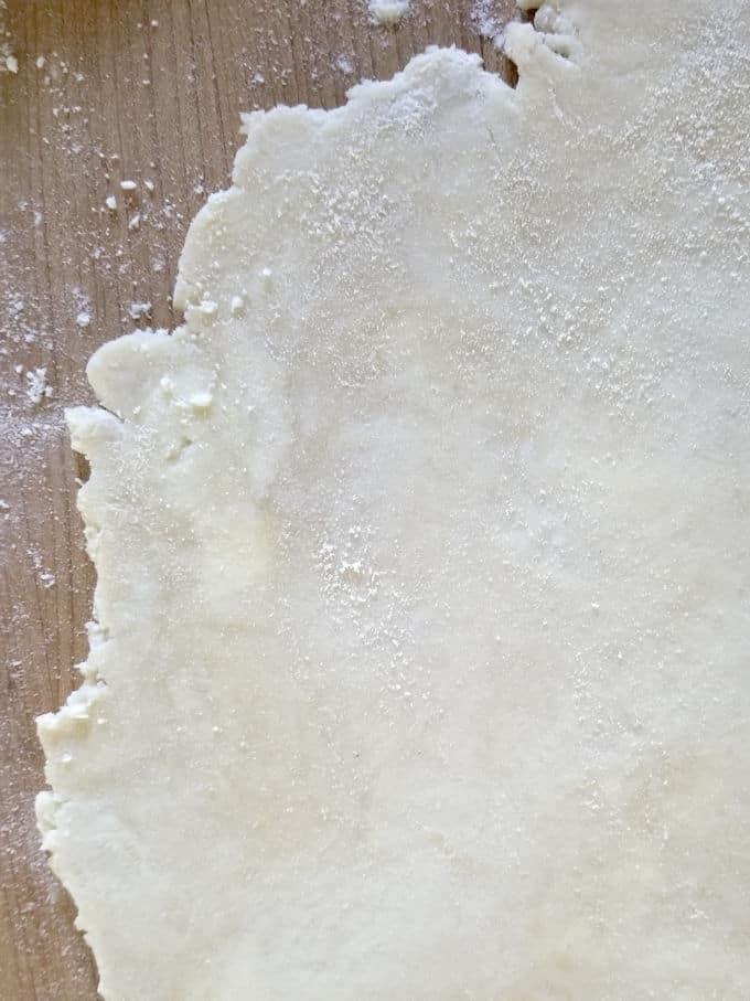 a sheet of dough for sourdough pie crust on a work surface