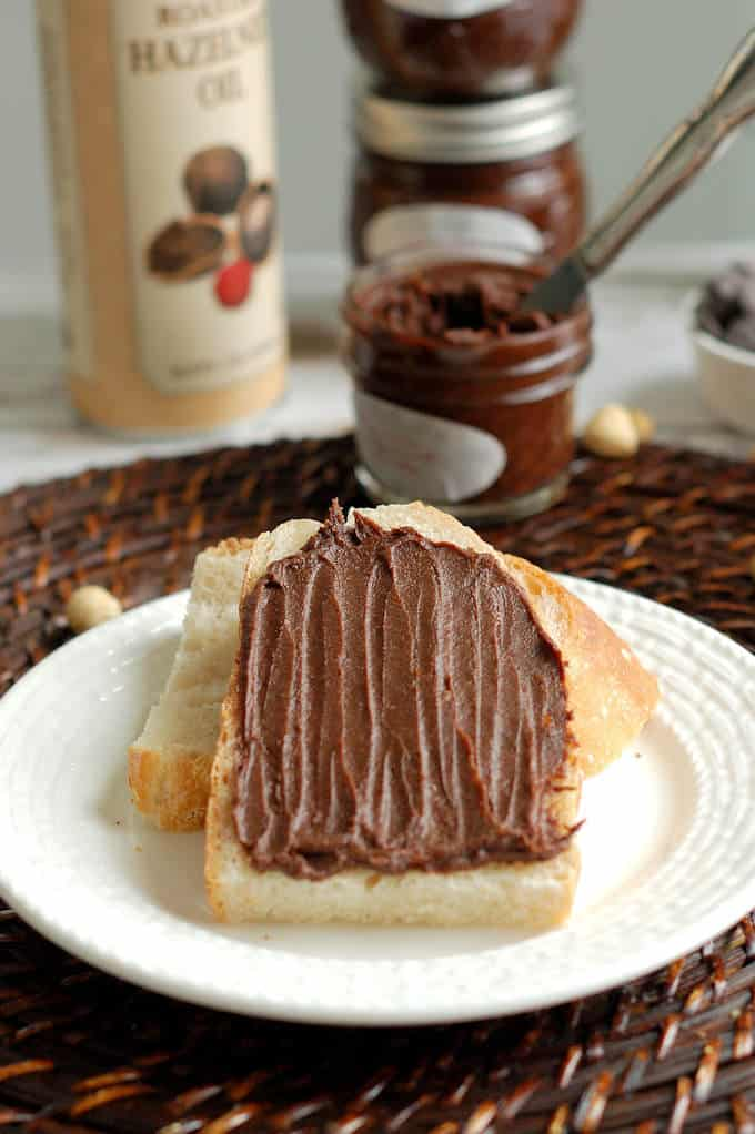 a slice of bread topped with homemade nutella
