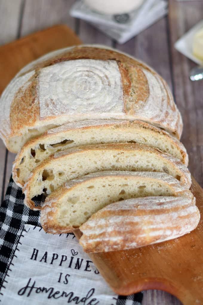 a sliced loaf of sourdough semolina bread on a cutting board