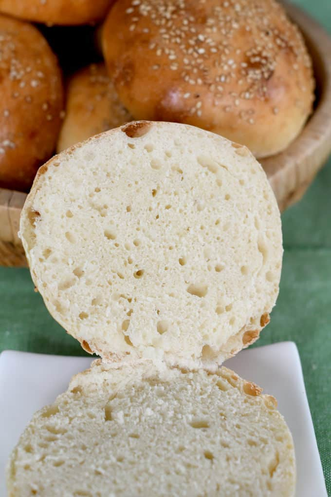 showing the crumb on a sourdough hamburger bun