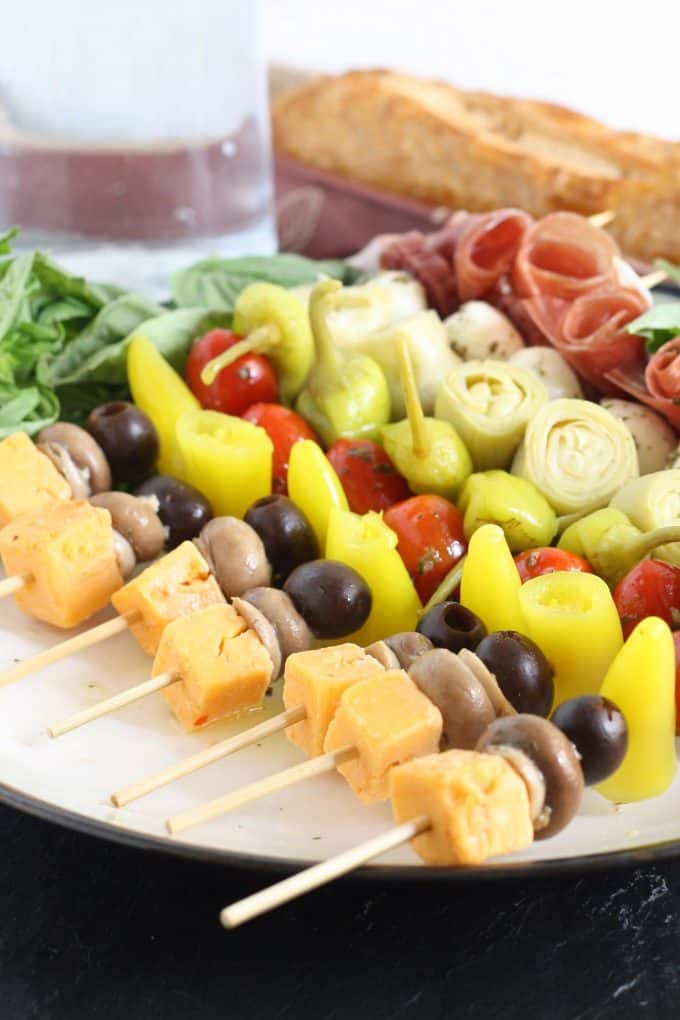 antipasto skewers with loaf of bread