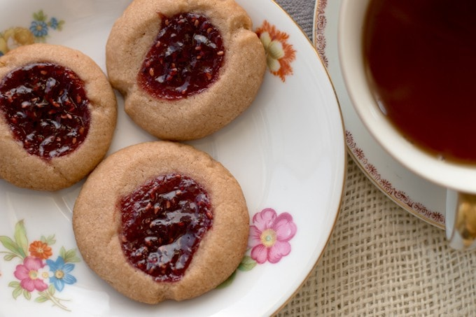 Raspberry chocolate shortbread thumbprint cookies - only 6 ingredients! These cookies are so easy to make and are my new Favorite! | honeyandbirch.com