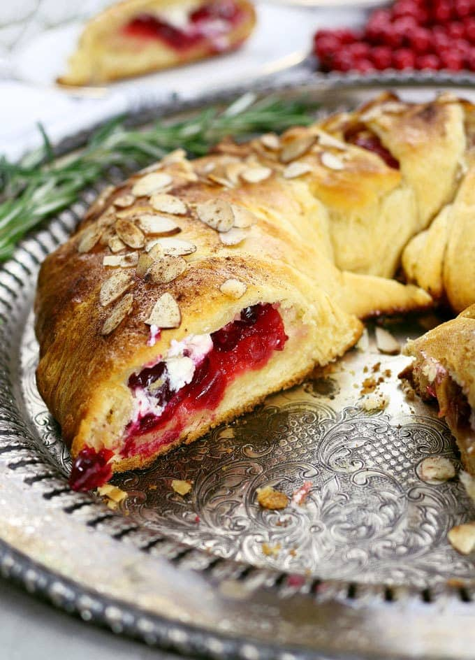 The holidays just got better thanks to this easy cranberry goat cheese crescent ring. It can be an appetizer or dessert recipe - it's the perfect mix of sweet and tart! | honeyandbirch.com