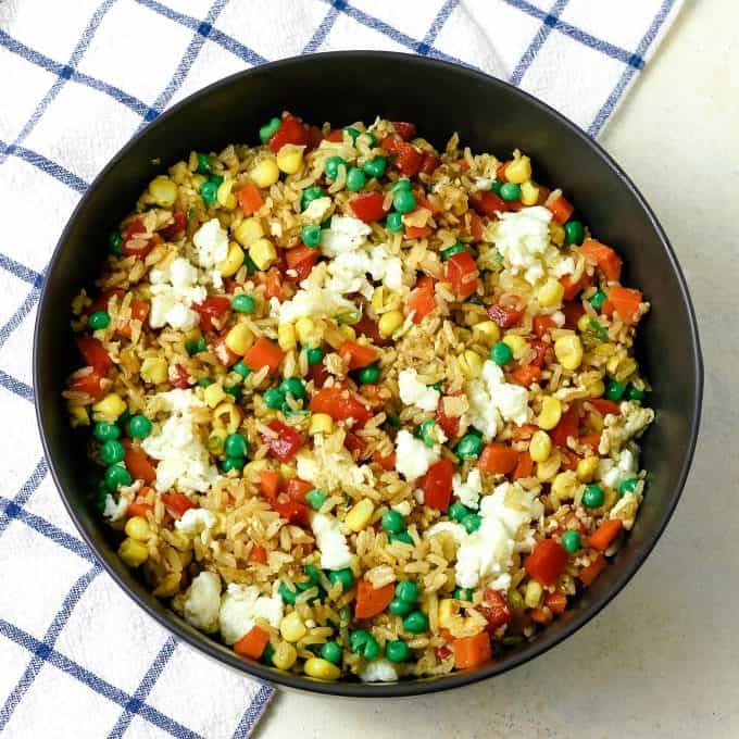 veggie fried rice in a grey bowl