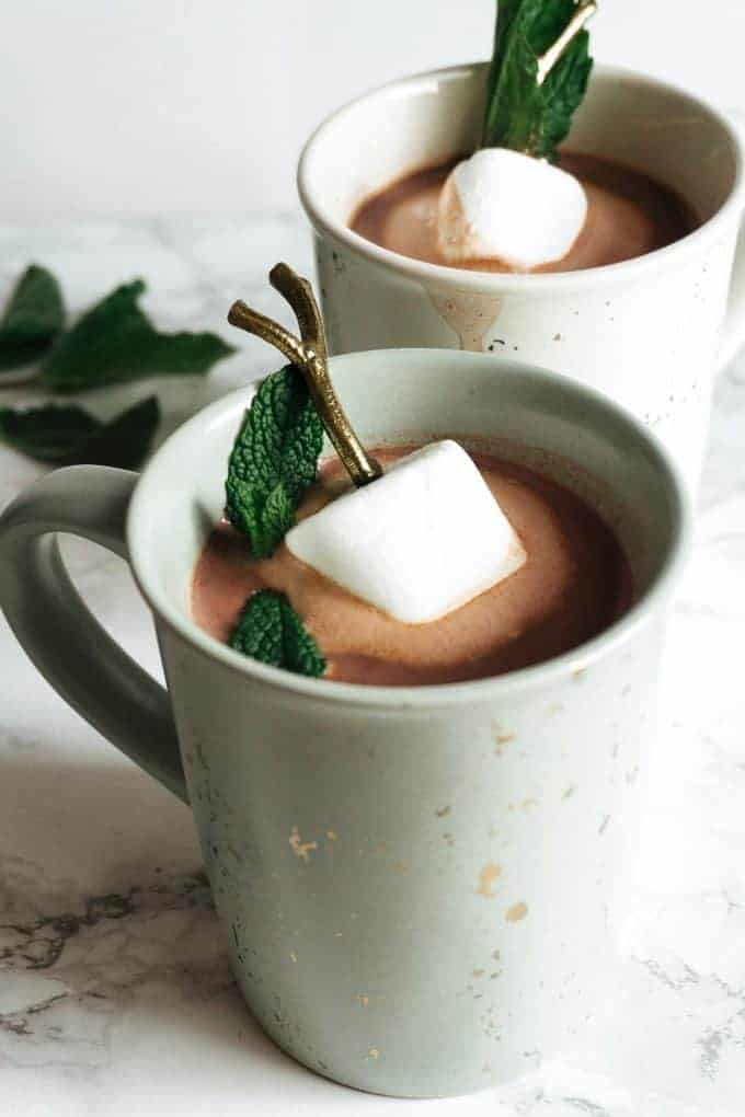 two mugs of boozy mint hot chocolate