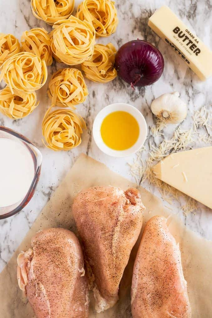 chicken tagliatelle ingredients including raw chicken oil, cream, and parmesan