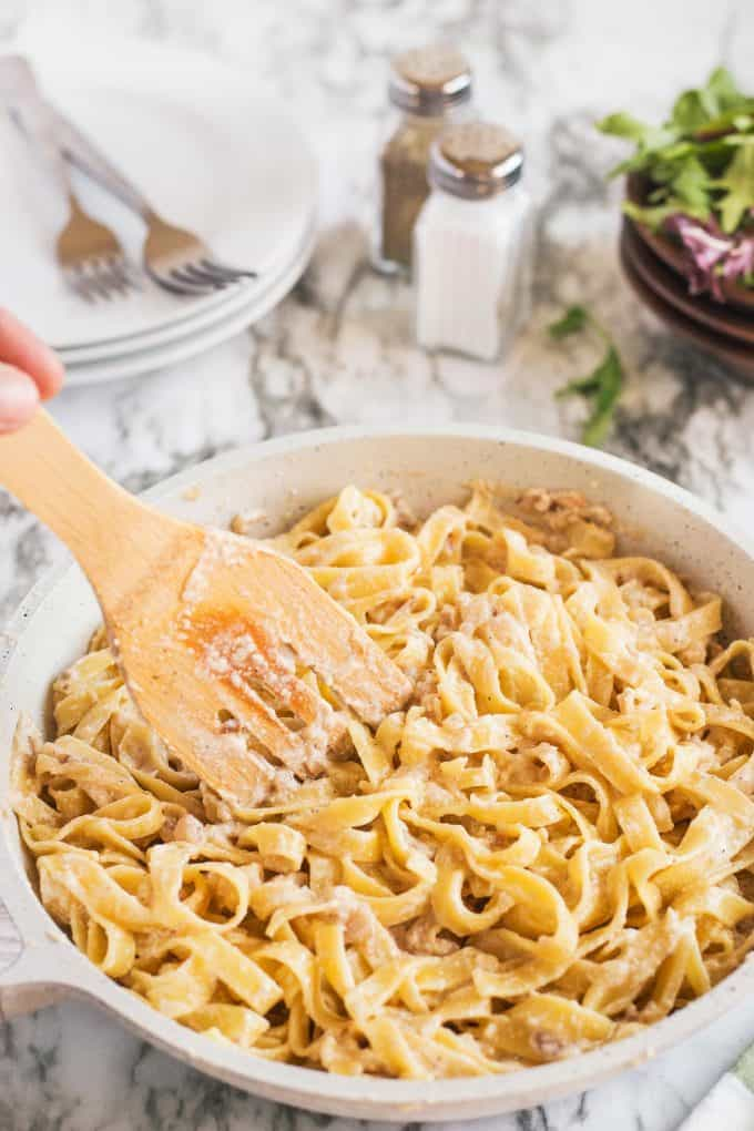 creamy chicken tagliatelle with a wooden spoon