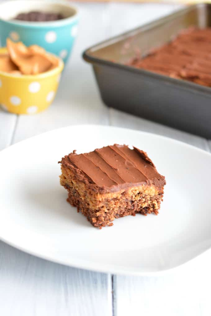 Chocolate Peanut Butter Brownie on a white plate in front of a brownie pan.
