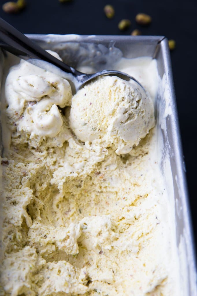scooping Pistachio Ice Cream from a loaf pan