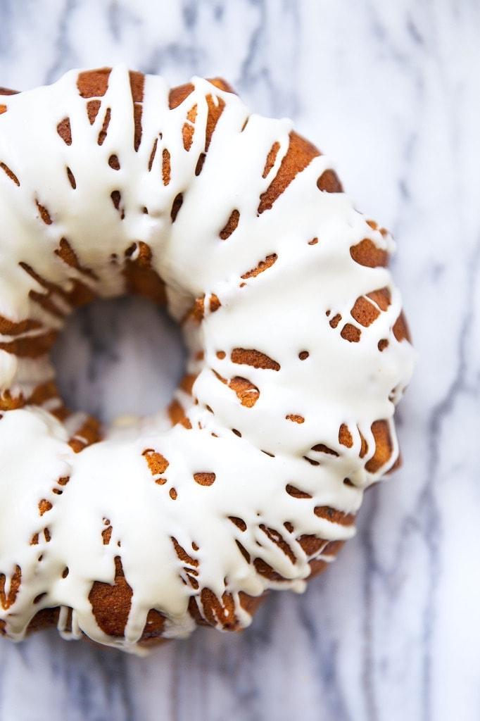 A spiced sweet potato bundt cake with pecan streusel and topped with a maple syrup glaze | via Broma Bakery | #sweetpotato #bundtcake