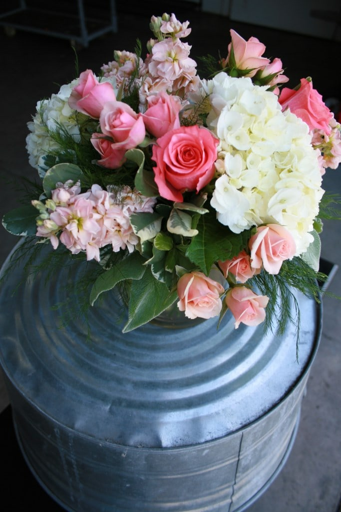 Coral, peach, and ivory centerpiece. Centerpiece and Aisle floral arrangement.
