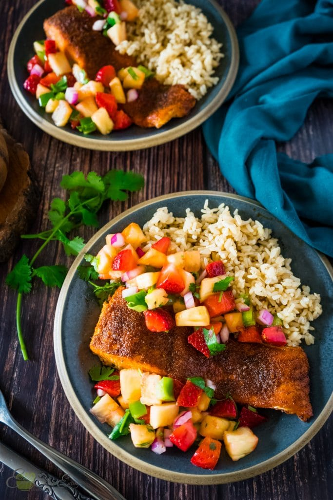 salmon air fryer served with instant pot brown rice, strawberry pineapple salsa.