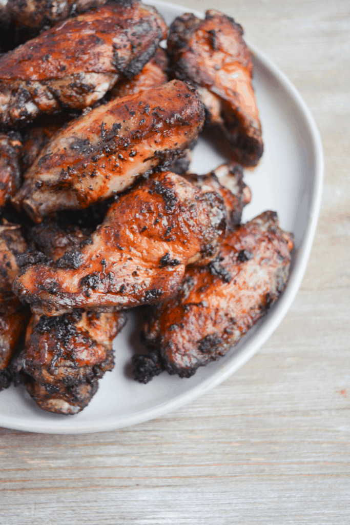 plate of jamaican jerk chicken wings cooked in the air fryer