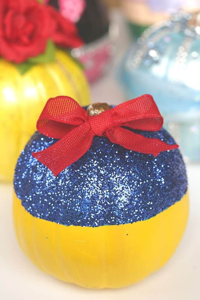 This no-carve Disney Snow White Pumpkin really is the fairest of them all. This easy no-carve pumpkin is a fun Halloween craft for kids.