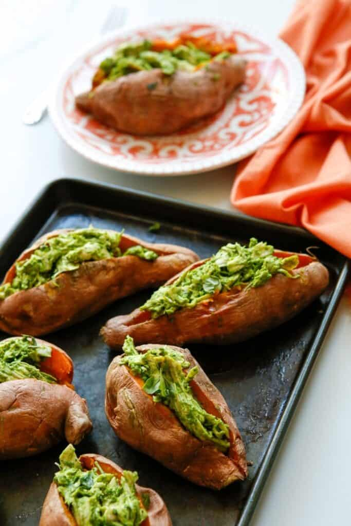 Enjoy a dairy-free and flavorful dish when preparing the Pesto Chicken Stuffed Sweet Potatoes. You can prepare this Whole 30 recipe in less than two hours. You will love how easy this sweet potato recipe is to make. This baked sweet potatoes recipe is so delicious.