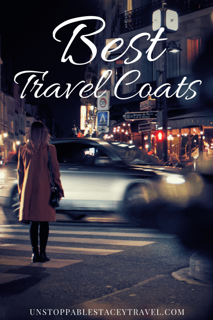 "Pinterest pin: Traveler with best travel jacket stands at crosswalk at night as the lights of the European city whiz by. Text reads"" Best Travel Coats"""